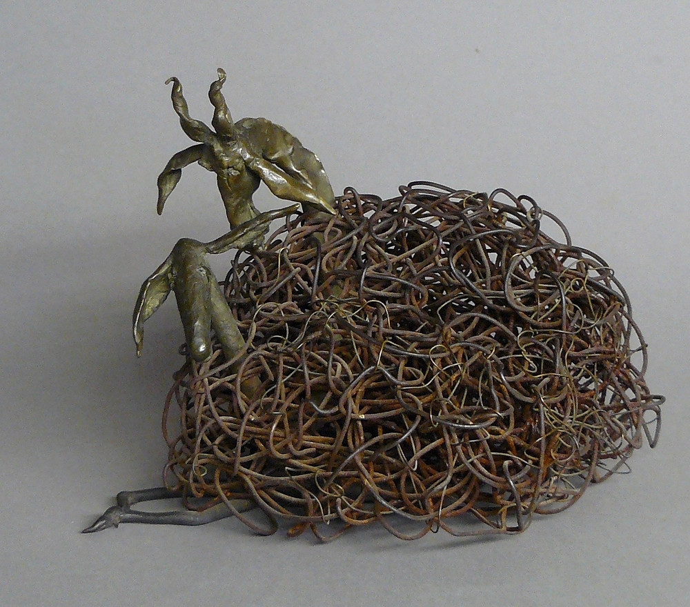bronze sculpture of a ram leering at a ewe, wool is a rat's nest of wire