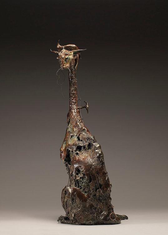 Bronze sculpture of 2 woodpeckers building a cat.