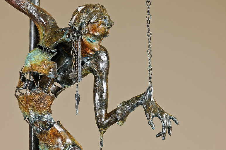 Detail of a bronze female nude marionette puppet in a fractured form wired together who is her own puppetmaster.