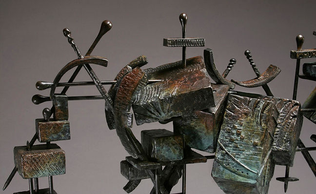 Detail of the rump of a bronze horse made of heavily textured boxes and skewers.