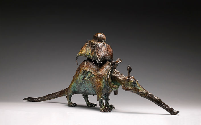 Bronze sculpture of an aardvark dressed in a plaid shirt on walk-about.
