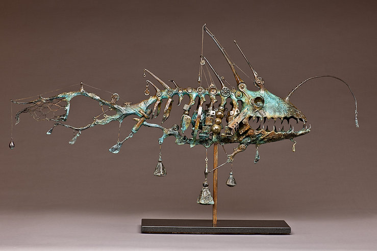 Angler Fish skeleton sculpture interwoven with fishing gear.