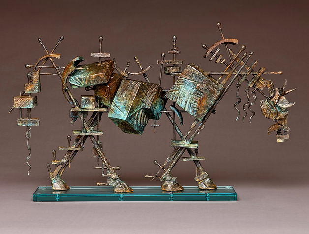 Standing bronze horse made up of various textured boxes held together with skewers.