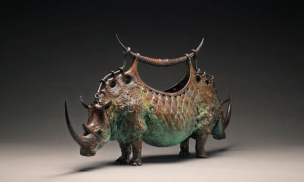 Bronze rhino vessel.