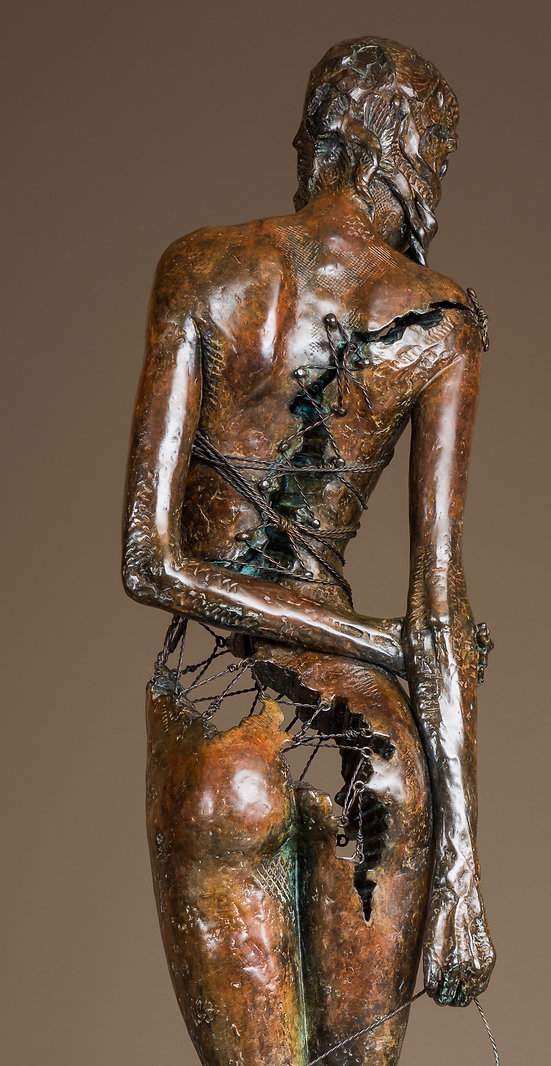 Detail of the back of a fractured female nude sculpture with wire connectors.