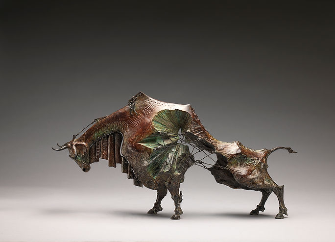 Bronze ox sculpture with crystaline structure and wiring.