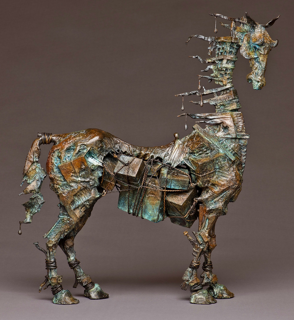 bronze sculpture of a horse made out of gift boxes