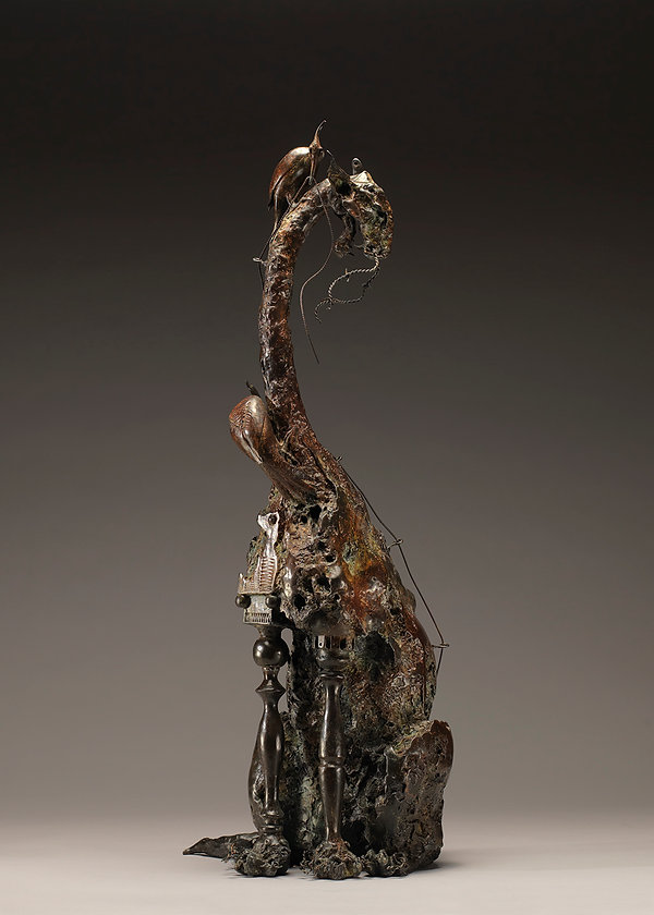 Bronze sculpture of 2 woodpeckers builing a cat.