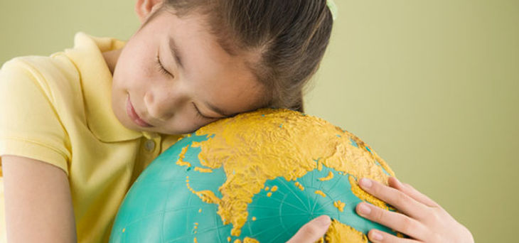 Girl hugging globe