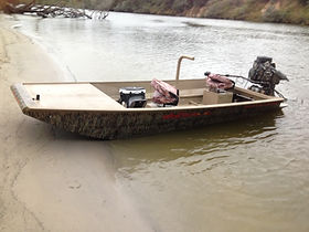 custom welded venom boat with Mud Buddy mud motor surface drive
