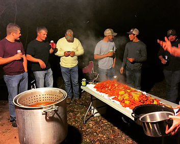 Venom Outdoor friends and family enjoy crawfish boil