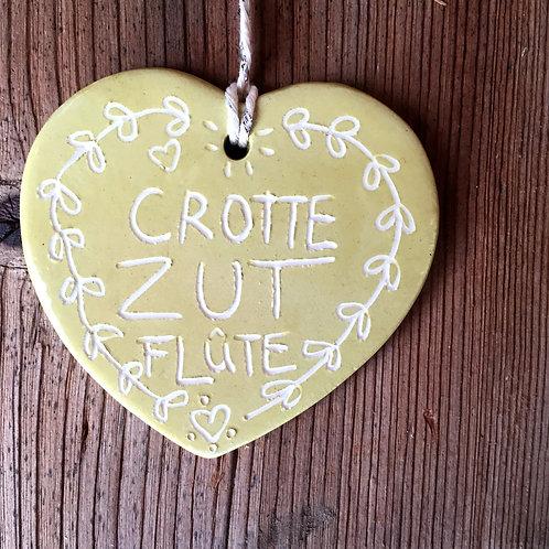 """Le médaillon restons polis """"crotte zut Flûte"""""""
