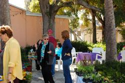 Guests enjoy sunshine in garden