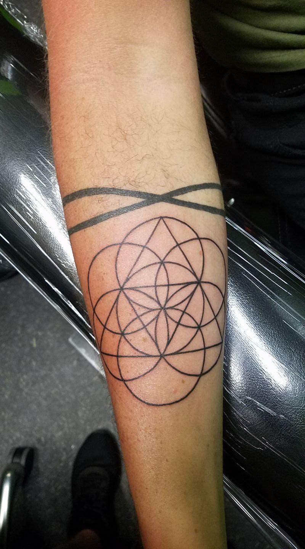 sacred g tatoo