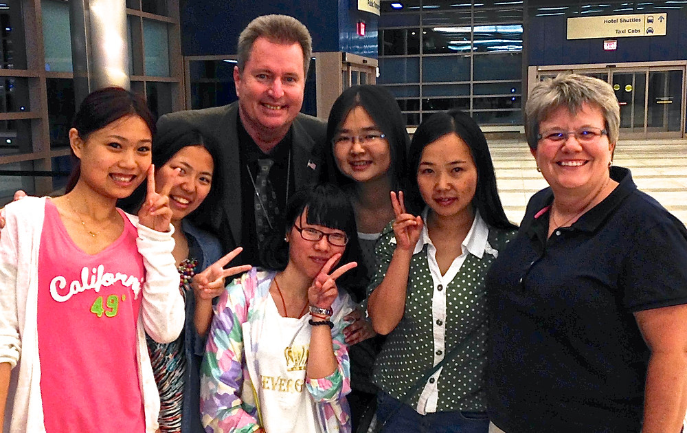 Chinese students forgotten at the airport. Detective Pete and Becky wait with them for their ride.