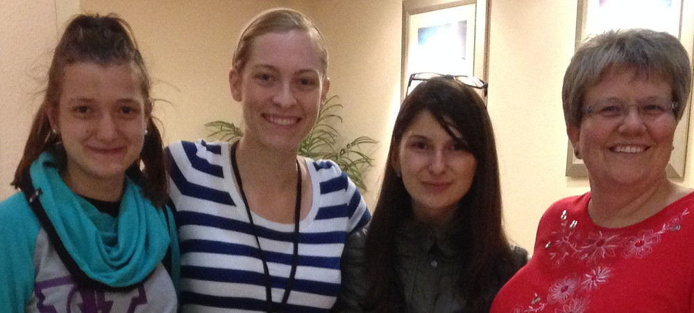 Becky & another volunteer at the hotel with J-1 students after another late night at the airport.