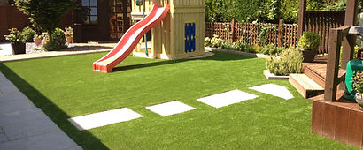 Back garden with play area.JPG
