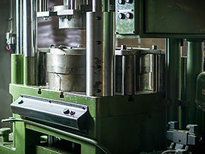 Our big hydraulic press used to shape tinplate and sheet metal