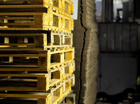 Stack of pallets and cartons side by side in Teksan's warehouse