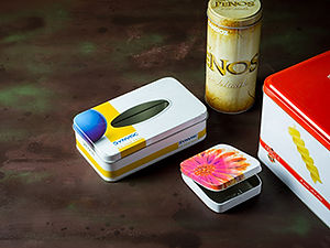 Promotional tin cans used for menstrual peds, tongue depressor, paper tissue and pasta