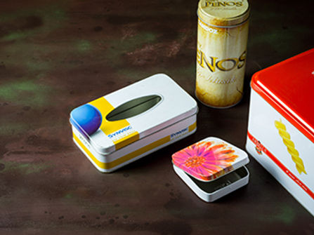 Four promotional tin cans used for Kotex menstrual peds, tongue depressors, paper tissues and pasta