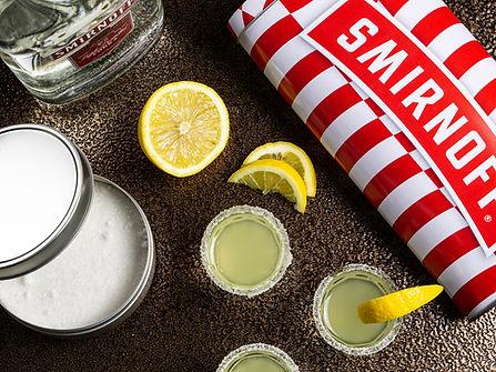 Custom Smirnoff tin and lemon drop shots on the bar