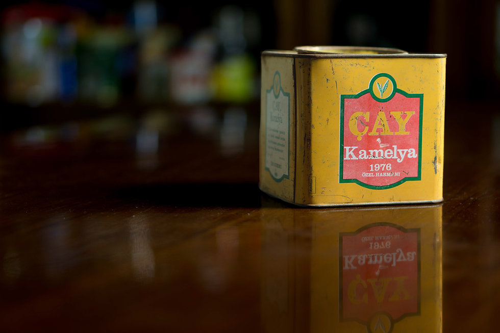 Vintage tea tin on a dark brown table