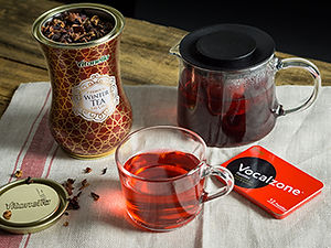 Winter tea and cough drops in a tin can on a wooden table