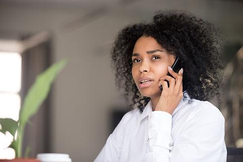 Thoughtful African American woman talk o