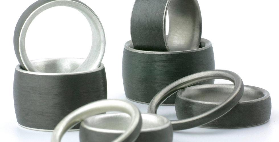 Carbon Ringe mit Silber, Gold oder Titan - ovaler Querschnitt