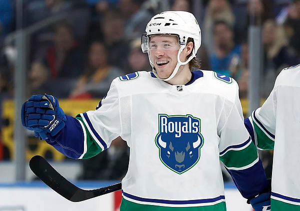 Boeser with royals jersey.webp