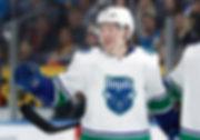 Boeser with royals jersey.png
