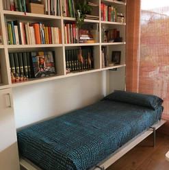 Libreria con cama plegable