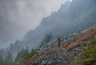A hiker battles the elements
