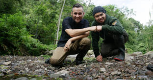 Myke Clarkson and our manager Nathan with a Blue Coral Snake (Calliophis bivirgata)