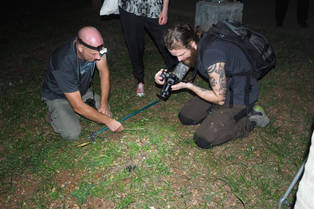 Photographing a water snake in North Jakarta with people from the UK (Andy) and Sweden (Jacob, Emma)