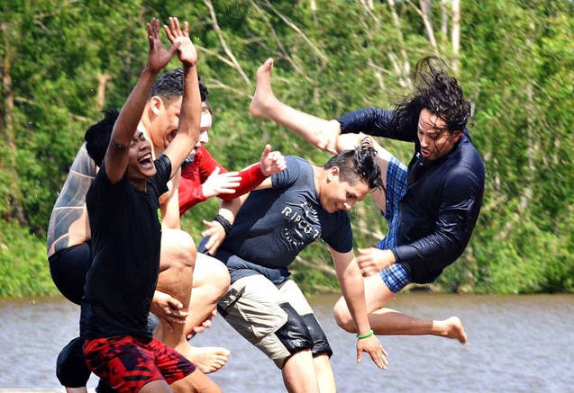 Jumping in a river in Borneo