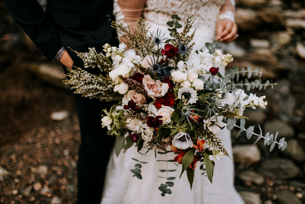 Winter Bridal Bouquet with wild flowers and wood setting