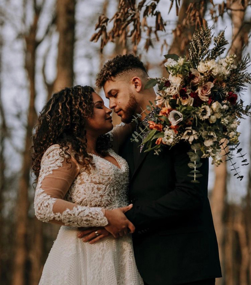 Gia and Kerwin holding Winter Bridal Bouquet