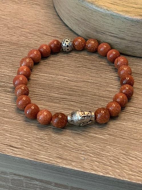 Bracelet avec billes oranges brûlées et Bouddha