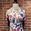 Thumbnail: Robe blanche avec fleurs estivales