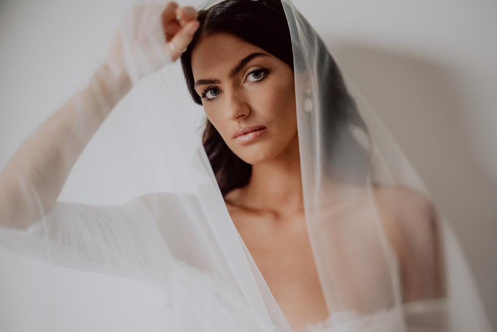 bride looking through two tier wedding veil