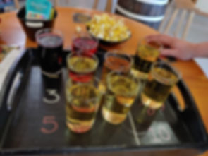 a flight of hard cider in our tasting room