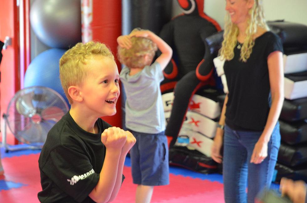 An excited boy enjoying his Ninja Skillz class