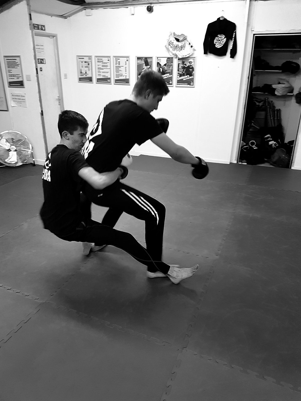 Two cda students grappling in a self defence lesson