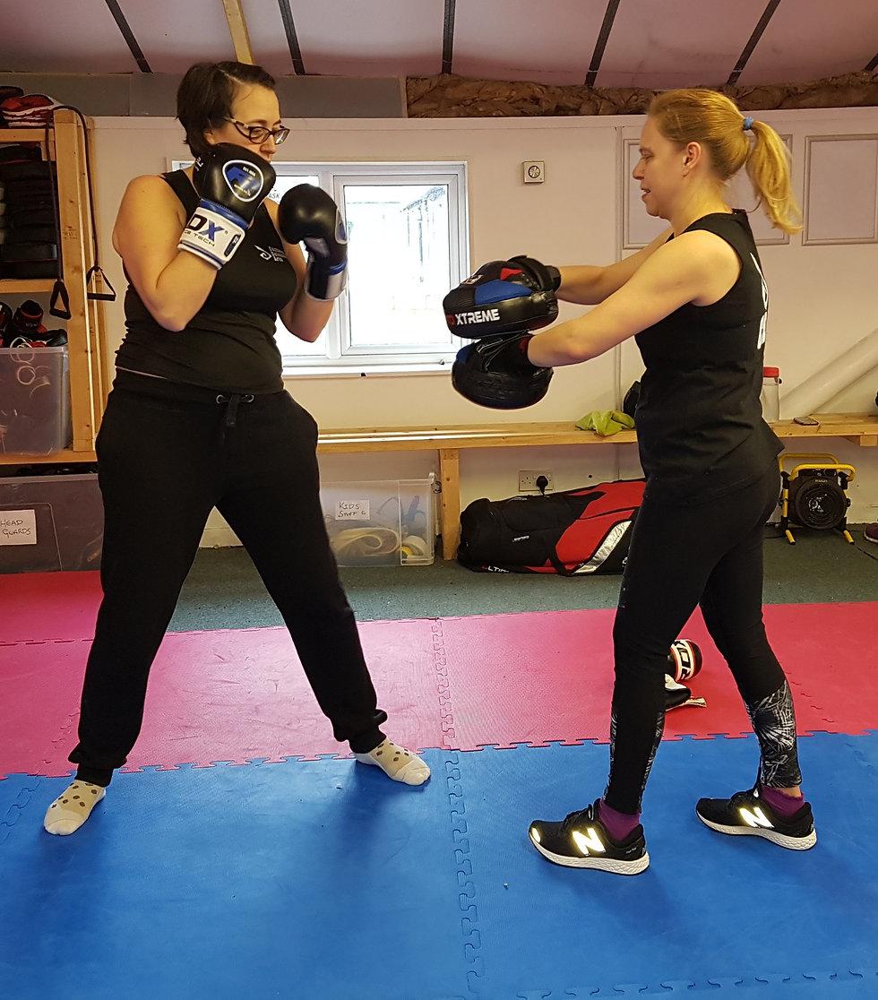 two women in a fitness kickboxing class