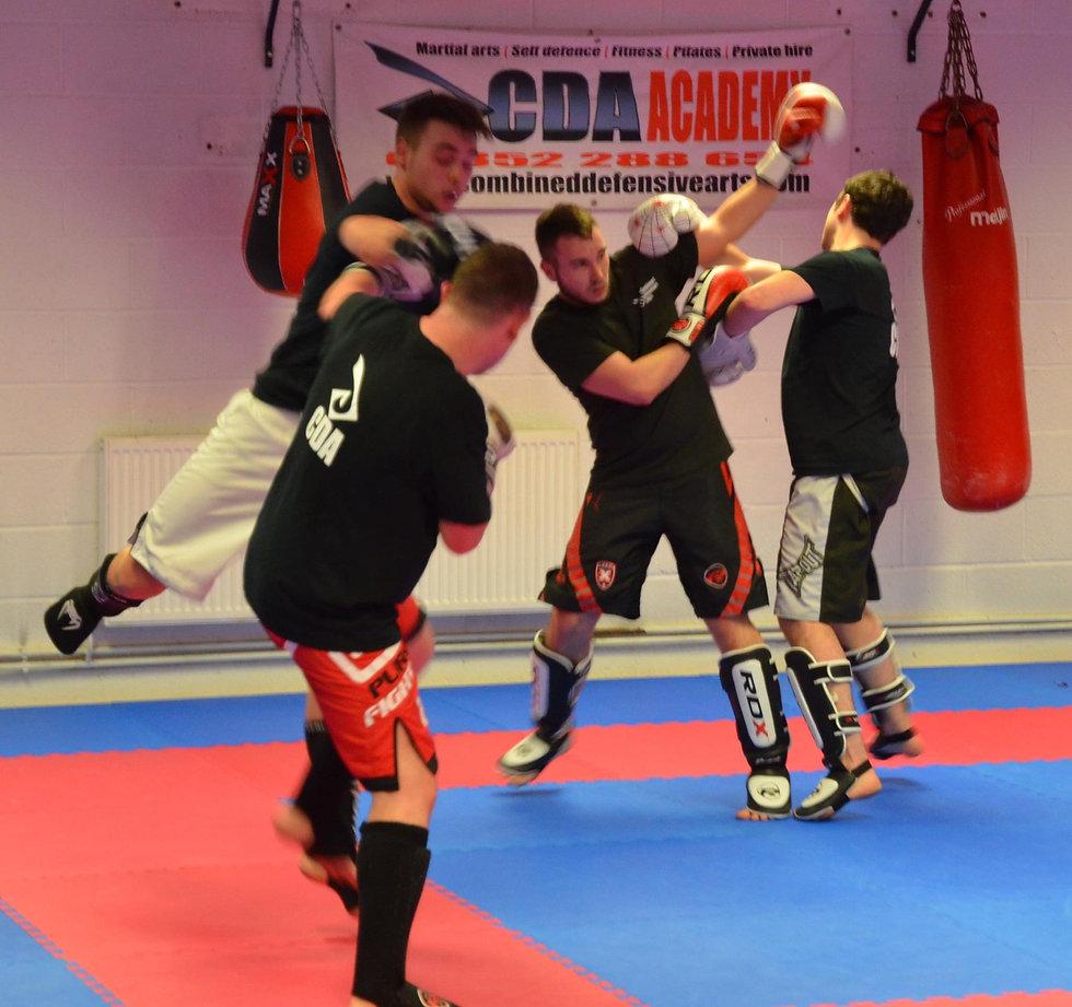 4 kickboxers sparring