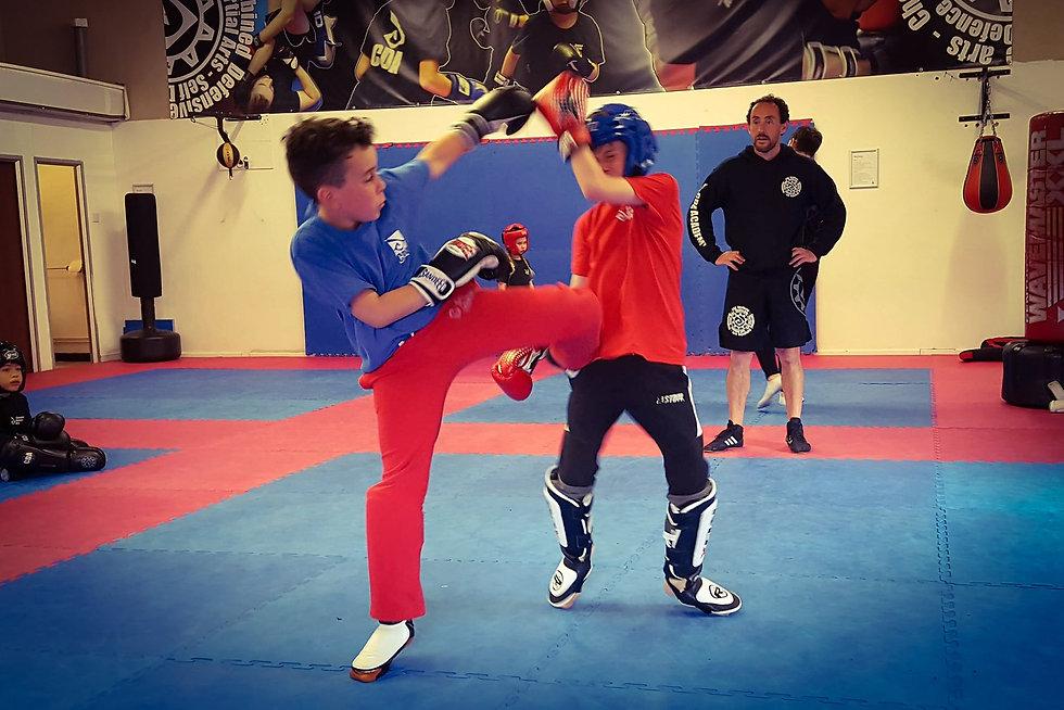 children kickboxing sparring