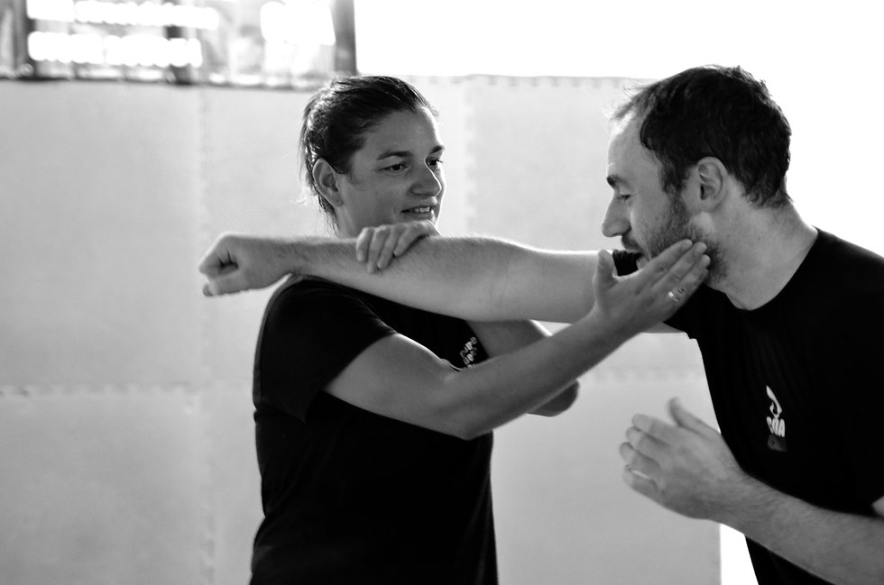Female student using jkd and kali trapping