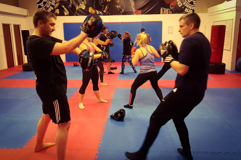 Image of mn and women at one of the CDA Academies Fitness clsses Cardio Kickboxing